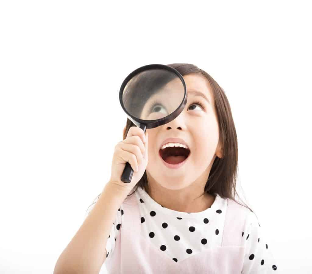 kid looking through spy glass to play i spy, mindfulness games for kids, mindfulness for kids, yoga and mindfulness for kids