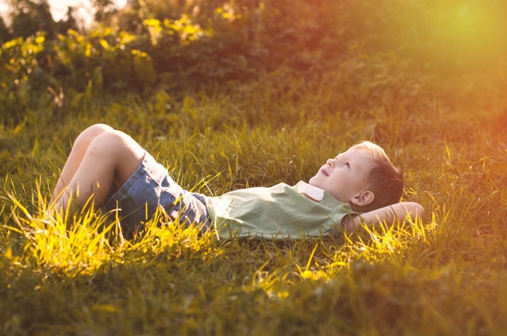 mindful resting outside gazing at the sky child practicing mindfulness