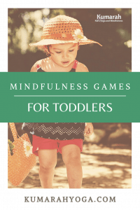 toddler playing outside looking for details in nature to play a mindfulness game