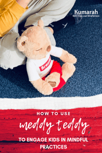 Meddy teddy sitting with a child practicing breathing and mindfulness