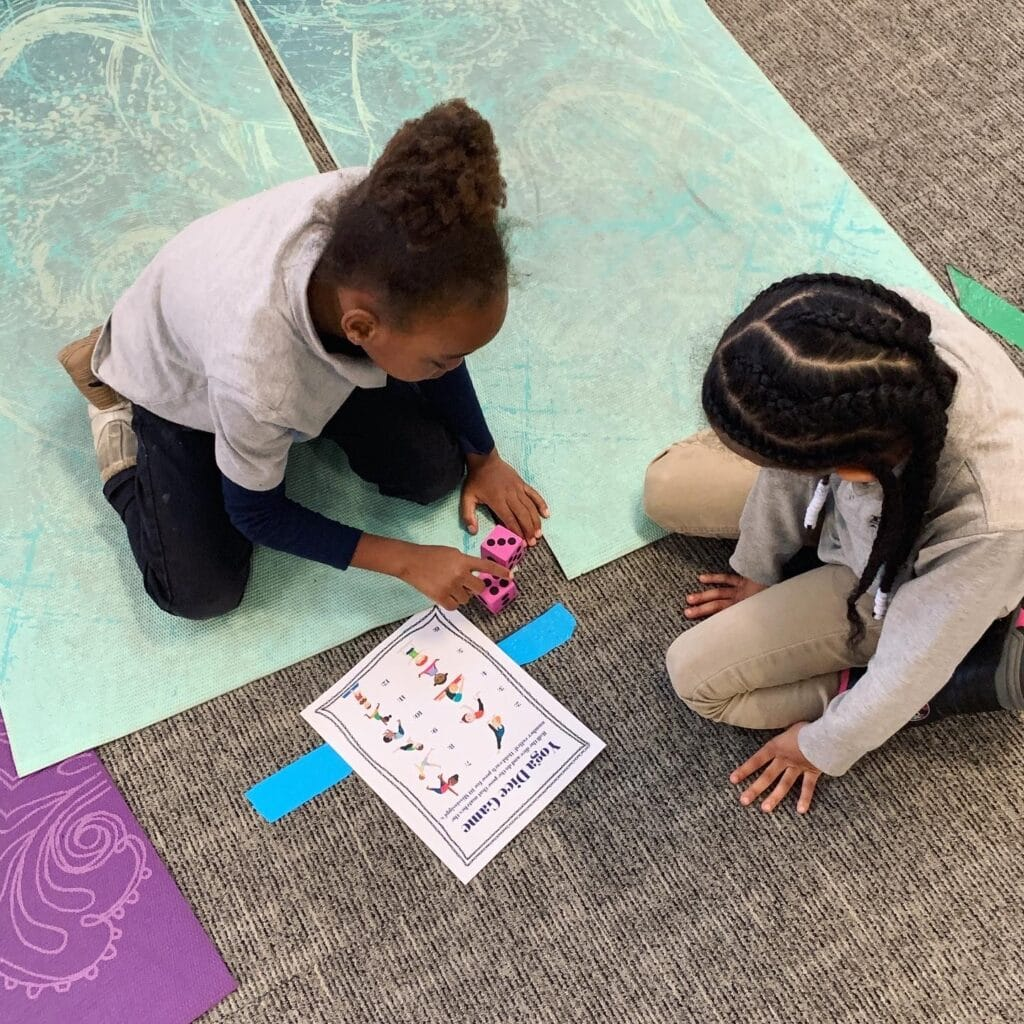 yoga games for kids, two kids playing the yoga dice game